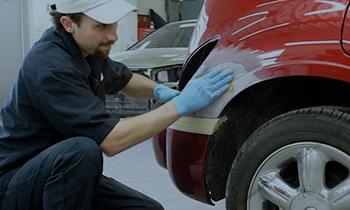 Maaco: Employee performing collision repair