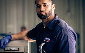 Maaco Employee on tool box