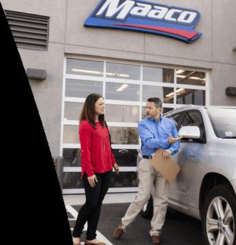 Maaco: Employee reviewing damaged vehicle