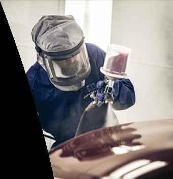 Maaco: Employee painting vehicle