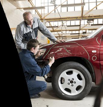 Maaco: Employee noting repairs needed on vehicle